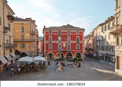 MONDOVI, ITALY - AUGUST 15, 2016: Moro square with people relaxing in a sunny summer day, blue sky in Mondovi, Italy.