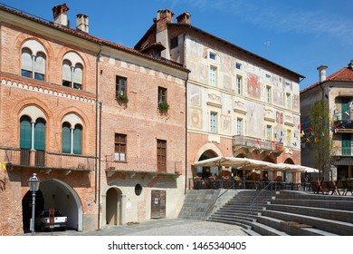 MONDOVI, ITALY - AUGUST 18, 2016: Ancient buildings with red bricks and frescos in a sunny summer day, upper city square in Mondovi, Italy.