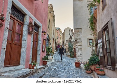 MONEMVASIA, LACONIA, GREECE - DECEMBER 15 2018: Christmas atmosphere in the medieval castle town of Monemvasia, Greece. Decorated store fronts for christmas in Monemvasia, Laconia, Peloponnese, Greece