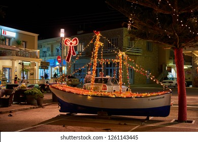 MONEMVASIA LACONIA, GREECE - DECEMBER 2018: Wooden Christmas ship decorated at night. In the Greek tradition (especially in the islands) it is common to ornament a ship instead of a tree for Christmas