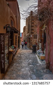 MONEMVASIA, LACONIA, GREECE - FEBRUARY 2018: Stone alley into the picturesque castle town of Monemvasia during winter. Architectural stone buildings and beautiful narrow paved streets in Monemvasia