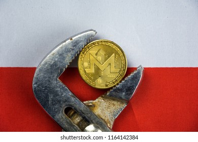 Monero coin being squeezed in vice on Poland flag background; concept of cryptocurrency monero (xmr) under pressure. Prohibition of cryptocurrencies, regulations, restrictions or security