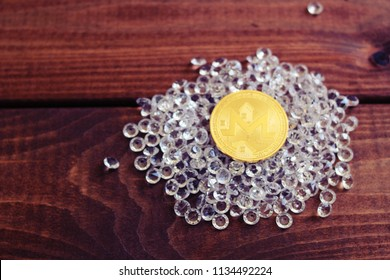 Monero coin on diamonds. Profit from investment in monero concept.