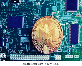 Monero coin on motherboard background. Monero mining concept.