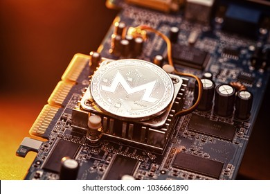 Monero Cryptocurrency coin on a PC computer graphic card, crypto currency mining concept