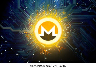 A monero cryptocurrency hologram coin form hovvering over a computer circuit board