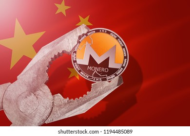 MONERO (XMR) coin being squeezed in vice on China flag background; concept of monero cryptocurrency under pressure. Prohibition of cryptocurrencies, regulations, restrictions or security