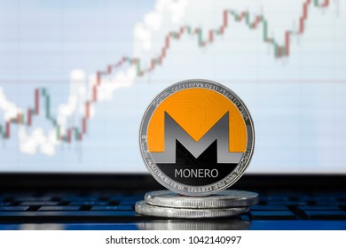 MONERO (XMR) cryptocurrency; physical concept monero coin on the background of the chart