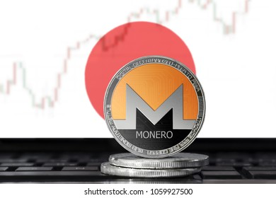 MONERO (XMR) cryptocurrency; physical concept monero coin on the background of the flag of JAPAN
