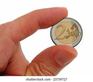 Money: 2 euro coin in hand
