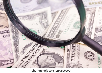 Money American dollars background with magnifying glass. Copy space. Banking. Go to Bank. Growth.