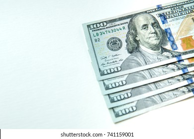 money American hundred dollar bills .Pile of various currencies isolated on white background.Closeup of assorted American banknotes.US currency scattered on the table.america currency.dollor currency.