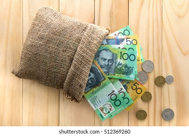 Money, Australian dollars (AUD), spilled out from a bag