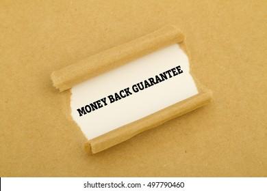 """""""Money back guarantee"""" written under torn paper."""