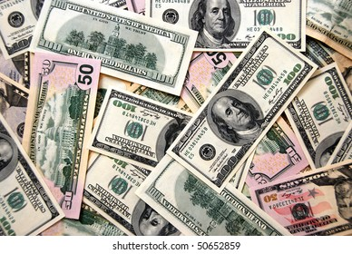 Money background of $100 and $50 bills in USA currency