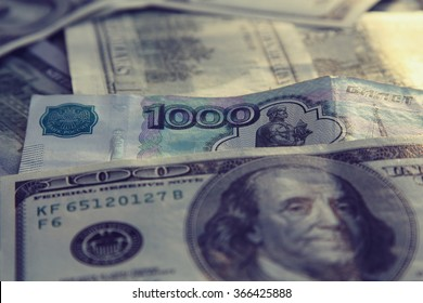 Money Background with american hundred dollar and russian 1000 rubles bills . Business and currency concept