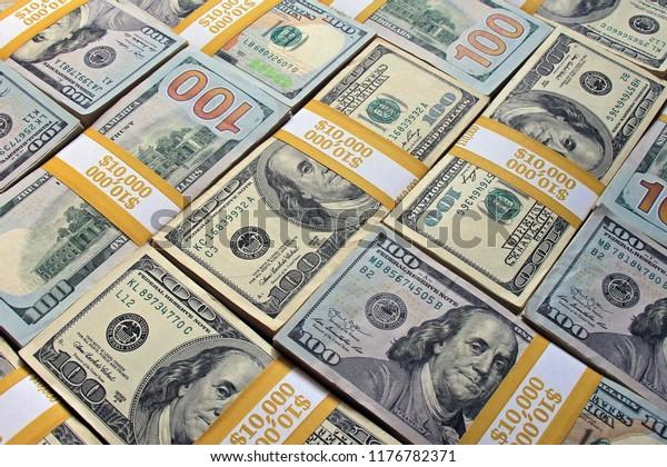 Money background from stacks of $100 dollar bills. Stack of dollars as a background. Cool background made from cash stacks. Piles of US dollars as a background.