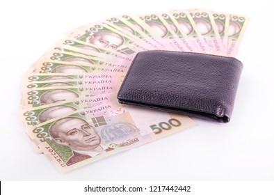 Money background, Ukrainian hryvnia isolated over white background with a black wallet nearby, currency of Ukraine