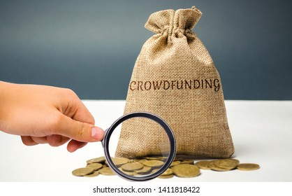 Money bag with coins with the word crowdfunding. Voluntary association of money or resources via the Internet. Support recipients. Financing start-up companies and small businesses. Co-investment