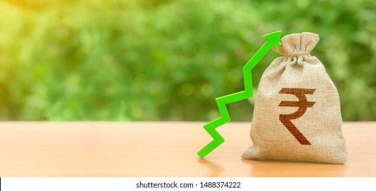 Money bag with indian rupee symbol and green up arrow. The growth of the national economy and the strength of the exchange rate. Investment attraction. loans subsidies