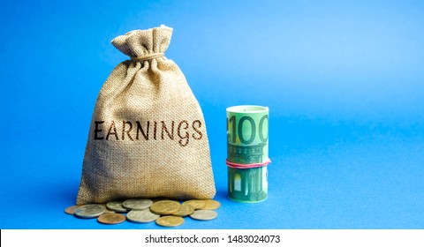 Money bag with the inscription Earnings and Euro bills. Net benefits of a corporation's operating. Profit, income, budget, capital. Ebitda. ROI. ROR