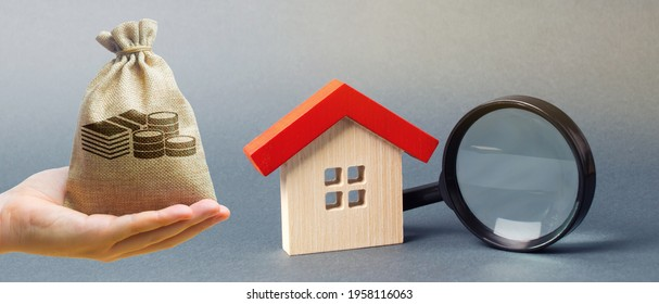 Money bag, miniature house and magnifying glass. Home appraisal. Property valuation. Choice of location for the construction. House searching concept. Search for housing and apartments. Real estate