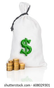 Money bag and stacks of coins on white background
