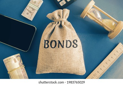 Money bag with the word Bonds. A bond is a security that indicates that the investor has provided a loan to the issuer. Equivalent loan. Unsecured and secured bonds. - Shutterstock ID 1983765029