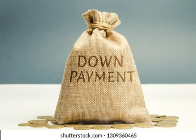 Money bag with the word down payment. Payment used in the context of the purchase of expensive items such as a car and a house, whereby the payment is the initial upfront portion of the total amount