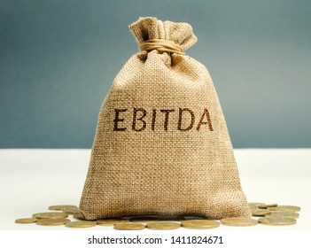 Money bag with the word Ebitda. Earnings before interest, taxes, depreciation and amortization. Financial result of the company. Cash flow estimate. Financial performance ratio. Pretax profit.