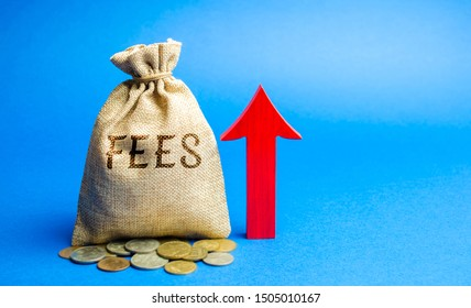 Money bag with the word Fees and up arrow. Duty increase concept. Trade wars. Import and export quotas. High taxation. Free trading zone. Business and Finance