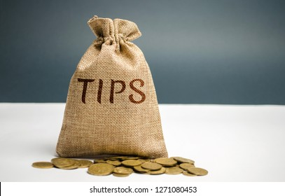 Money bag with the word Tips. Award for good service in the cafe / restaurant. A gratuity is a sum of money customarily given by a client or customer to a service worker in addition to the basic price