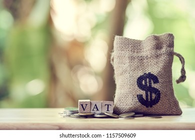 Money bags and Pay Annual income (VAT) for the year on wood. using as background business concept and finance concept with copy space  for your text or  design.