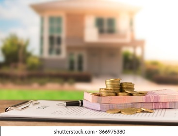Money, banknote on mortgage loans document or loan contract credit for housing with real estate property background.