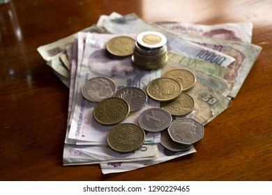 money and banknotes on a wooden background