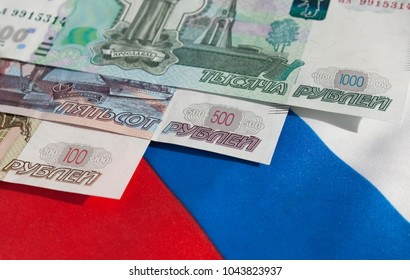 Money banknotes rubles on the Russian flag background