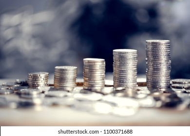 Money bars as financial growth. Euro coins arranged in piles. Banking, finances, taxes, financial operations.