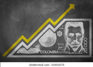 A money bill drawn on a chalk board looking like a growth graph with an upwards pointing arrow symbolizing economic relationships.
