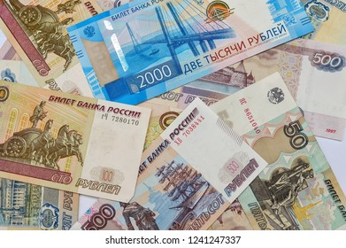 Money bills Russian currency 100 500 50 and 2000 rubles on the table, the country's economy, loan payment bonus loan