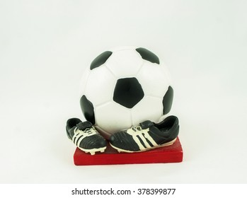Money box as the ball and shoes on a white background
