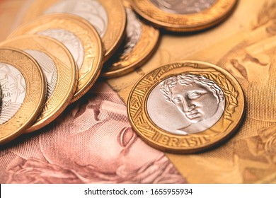 Money from Brasil. Real Currency, Dinheiro, Reais, Coin, Brazilian coin. Many coins on Brazilian money notes.
