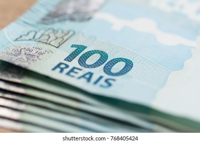 Money from Brazil. Notes of Real, Brazilian currency. Concept of economy, inflation and business. pile os bills.