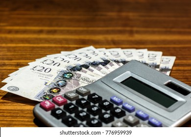 Money .British currency and calculator.