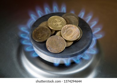 Money burned on a gas stove. The growth of utility tariffs.