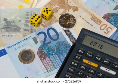 Money and calculator and dice  in year 2016