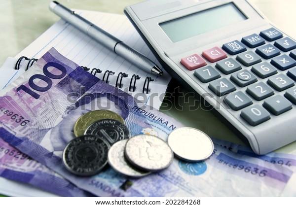 Money, calculator, notebook and pen Photo of Money, calculator, notebook and pen