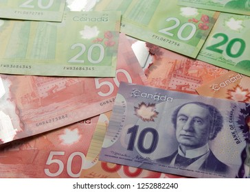 Money from Canada. Dollars. Canadian currency. Top view of bills spread and variation of amounts.