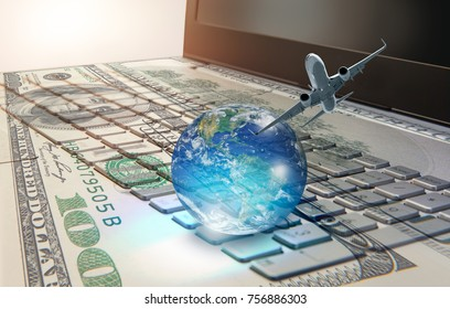 "Money cash banknote on laptop keyboard, digital money and e-commerce concept ""Elements of this image furnished by NASA """