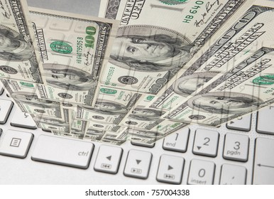 Money cash banknote on laptop keyboard, digital money and e-commerce concept