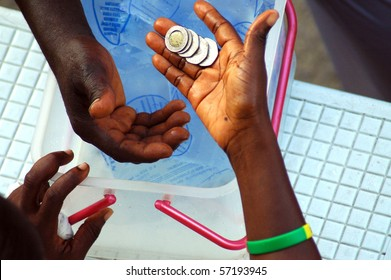 Money changing hands on the street of ghana